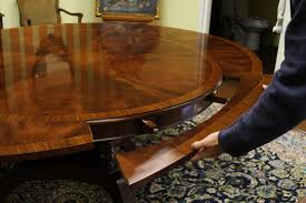 round to oval mahogany dining table high end designer furniture