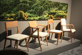 brazilian wood furniture. these chairs represent beautiful brazilian design through their rich wood and sumptuous leather sossego furniture