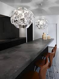 statement lighting. Shimmering Statement Pendant Lights Above The Kitchen Island In A Modern And Industrial Home. Lighting .
