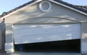 garage door off trackFive Signs Your Garage Door Springs Need Repair  Teds Garage News