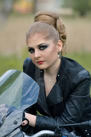 stunning fashionable dangerous angry serious biker with smokey makeup