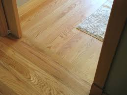 how to installing a hardwood floor glue down between two rooms in transitioning