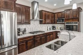 in total the floor plan accommodates 4 beds 3 baths and a fully finished walkout basement in the kitchen you ll find aristocraft cabinets with quartz