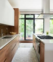 White wood kitchen Blue Warmcolored Wood Modern Kitchen With White Cabinets And Countertops Looks Chic Shelterness 15 Trendylooking Modern Wood Kitchens Shelterness