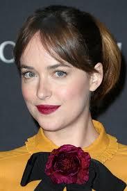 dakota johnson s raspberry lipstick contrasted beautifully with her yellow dress