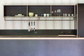 kitchen drop in sink metal backsplashe wood cabinet open cabinet and