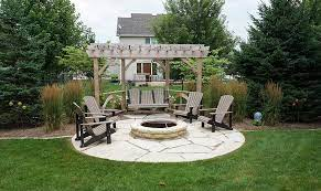 ted lare stone patio firepit pergola