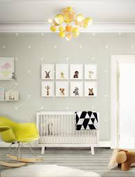 Such a cute the portraits on wall gray colored baby nursery animal theme  small star pattern above white wood crib modern