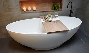 bath with timber bath caddy