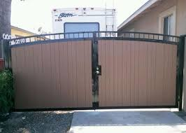 Image Yard Jj Fence Installed This Driveway Entry Gate In Torrance Ca It Is Double Swing Gate With Wood Grain Vinyl Boards And Features Brown Double Arched Rabindrapathabhabaninfo Jj Fence Vinyl Fence Gallery Vinyl Fence Installation Los Angeles