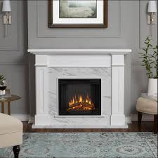 freestanding electric fireplace in white with faux marble