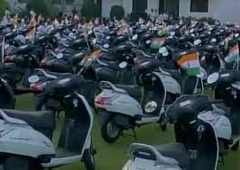 gujarat surat diamond trader gifts scooters to employee for good performance