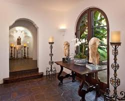 Spanish Style Home Decor  Collar City Brownstone. I love the tile, arches,