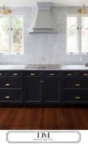 Windows Flanking Range Hood Sconces Over Window Gray Kitchen - Kitchens and more