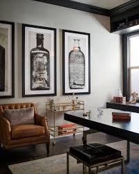 A glass-and-gold bar cart, brown leather armchair and oversized artwork of   Men's Office DecorVintage ...