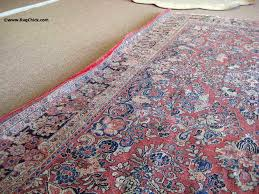 side curls on this damp sarouk rug