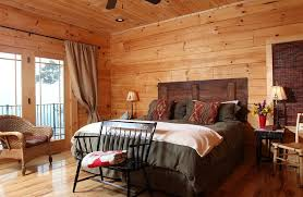rustic bedroom with barn wood headboard design log homes of america