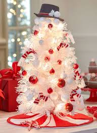 this is such a fun loving and beautiful christmas tree presented as a snowman a white christmas tree is decorated with red and white ornaments