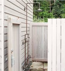 exterior shower fixtures. white washed wood planks walls system for outdoor shower space with free standing fixture exterior fixtures r