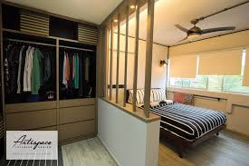 a series of panels serves as a divider between the walk in wardrobe and the rest of the bedroom arranged in an angle they provide privacy while still