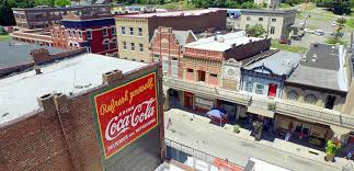 ghost signs reborn red coca cola murals refresh southern downtowns the coca cola company