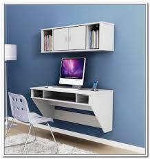 white floating puter desk by ikea a white wall mounted storage with a pair  of side