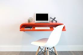 minimal float wall desk by orange22 shown in orange red