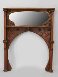 art nouveau gany fireplace mantel with carved whiplash lily pad fl design with a shelf shaped beveled mirror and column sides att