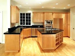 what color countertops go with maple cabinets light cabinets dark granite kitchen islands with maple cabinets