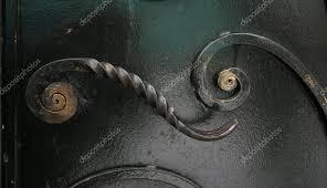 wrought iron door handles. wrought-iron door handle \u2014 photo by igorgolovniov wrought iron handles