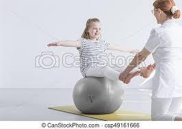 sitting on gym ball csp49161666