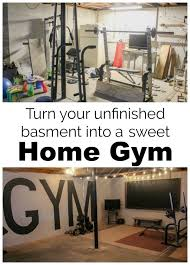how we created an industrial style home gym in our unfinished basement on a tiny budget