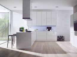 magnificent white faux wood flooring with white l shape modern kitchen cabinets added ceiling kitchen chimney hook in white kitchen designs
