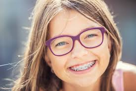 Image result for kid with braces
