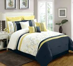 navy fl comforter elegant bedroom with simple set dark blue bedding yellow and bookcase under table lamp white