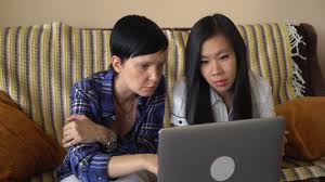 the creative office. asian young female listening and ask questions two casual women in the creative office or startup company working stock e
