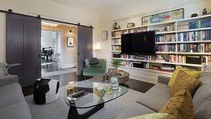 cozy living room with tv. The Built-in Bookshelves Are Filled To Brim With Owner\u0027s Library. They Cozy Living Room Tv Z