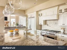 new pendant lighting. Stock Photo Beautiful New Kitchen Interior With Island Sink Cabinets And Pendant Lights In Home Lighting O