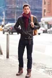 consider wearing a dark brown leather er jacket and deep blue jeans for a trendy and