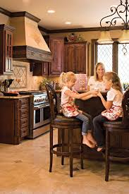 Italian-inspired kitchen with stucco walls, new cabinets and windows with  diamond panes reminiscent