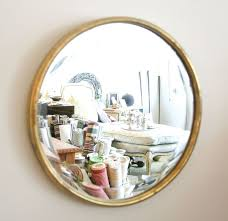 vintage style round wall mirror ideas using golden steel panel frame on white painted wall