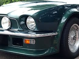 aston martin v8 classic. aston martin creates some of the most beautiful automobiles in world. they become even more so as mature. one such timeless beauty is v8 classic