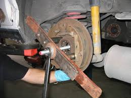 homemade wheel bearing puller. or, you can use a puller. this one was cheap-o model and broke on us. homemade wheel bearing puller e