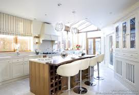 comfy and stylish these creamy leather bar stools reflect the style of this kitchen nicely