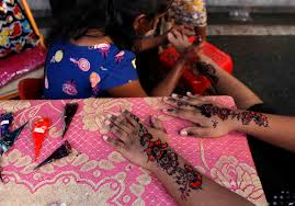 photo essay diwali the festival of lights why i love hinduism a n ethnic n w dries her hand after getting it painted henna for the