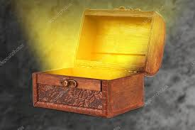 wooden treasure chest with a magical wi light coming out of t stock photo