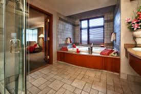 premium suites feature one bedroom wth king bed accommodations mini fridge microwave jacuzzi in bathroom separate sitting area and fireplace