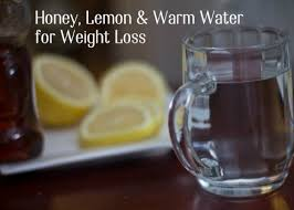 warm water with honey and lemon make a delicious drink that will help you feel full
