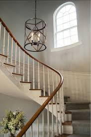 captivating chandeliers under 100 rustic chandeliers high ceilings window white wall stair plant