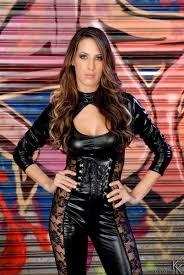 Kortney Kane strips off her tight black leather bodysuit Brand.